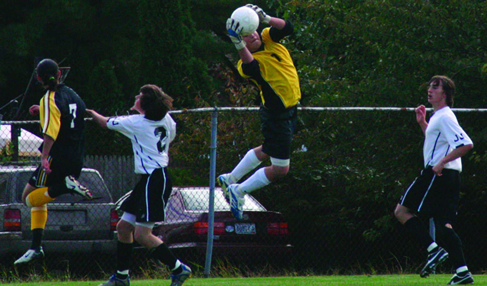 sports - pil socr - eric blanchard leaping save